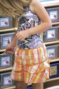 A kindergarten student in the Janesville School District puts materials away in her cubby at Madison Elementary School in May. Since 2000, the school's low-income population has doubled. More than half of its students are eligible for subsidized lunches. Photo Courtesy of THE JANESVILLE GAZETTE
