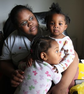 Bianca Lewis, at her Sun Prairie, Wis. apartment, Saturday, October 17, 2009 holding son Javeen Wilson, 15 months, right, and daughter Anija Wilson, 2 years.