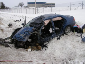 """A Whitewater woman died in this January 2009 crash on Highway 33 near the Dodge County Airport after her Honda Accord crossed the center line and struck an oncoming semi-trailer. Dodge County Sheriff Todd Nehls said his county consistently ranks among the top few Wisconsin counties in traffic fatalities, in part because of the number of vehicles traveling between Madison, Milwaukee and the Fox Valley. """"Our traffic counts are very high for a rural county,"""" Nehls said.   Photo courtesy of the Dodge County Sheriff's Office"""