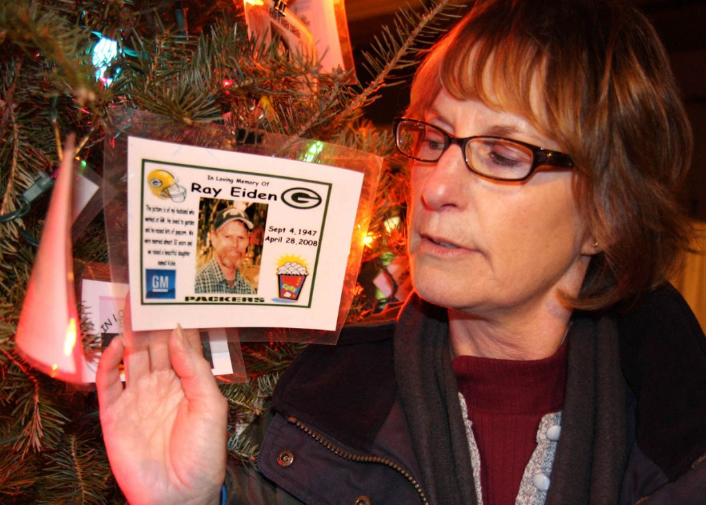 Karen Albrecht is pictured holding a picture of her brother, Raymond Eiden, who took his own life in April 2008. Wisconsin's suicide rate has been higher than the national rate for about a decade.WCIJ/JOSEPH W. JACKSON III