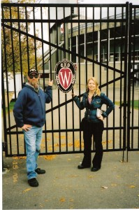 Vickie Eiden, pictured with father Raymond Eiden at UW-Madison's Camp Randall Stadium, found comfort in attending meetings at a local support group after her father's suicide. Talking openly about suicide helps to break down the stigma associated with suicide, prevention advocates say.CONTRIBUTED PHOTO