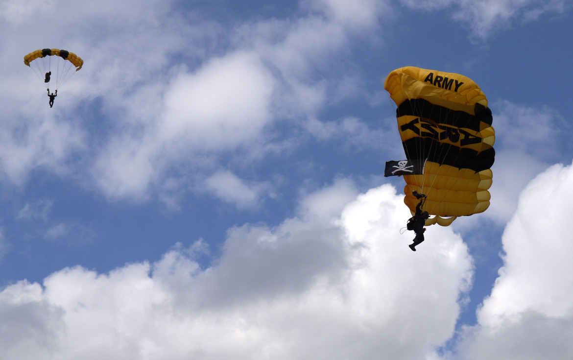 amid slow economy more wisconsin students heed the calls of a member of the army s golden knights parachute team spots his landing at the middleton high