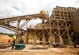 Preferred Sands' employees install a safety fence around the crushing area of the mine in Blair, WI, June 20, 2012.