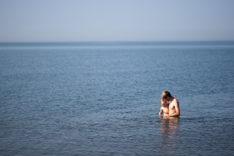 Andrew Harvey, 24, plays with his daughter in Lake Superior on a warm summer afternoon July 5, 2012.