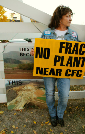 Shirley Evans of Modena, in Buffalo County, Wis., protests frac sand mining outside a sand industry conference in Minneapolis on Monday. Her sign refers to one of the first anti-sand victories in Wisconsin, when a Buffalo County board denied a permit for a proposed sand facility near the Cochrane-Fountain City School.
