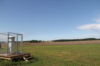 An air monitor stands among cornfields on the outskirts of New Auburn, which has two frac sand processing plants on its edges.