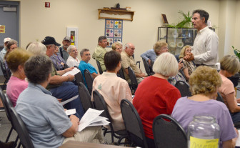 Crispin Pierce, an associate professor in the Environmental Public Health program at the University of Wisconsin-Eau Claire, discusses research on silica dust with Augusta community members June 19, 2013.