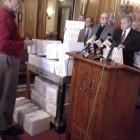 Lawmakers and others present 16,500 petition signatures at a press conference at the state Capitol Feb. 27, 2014.