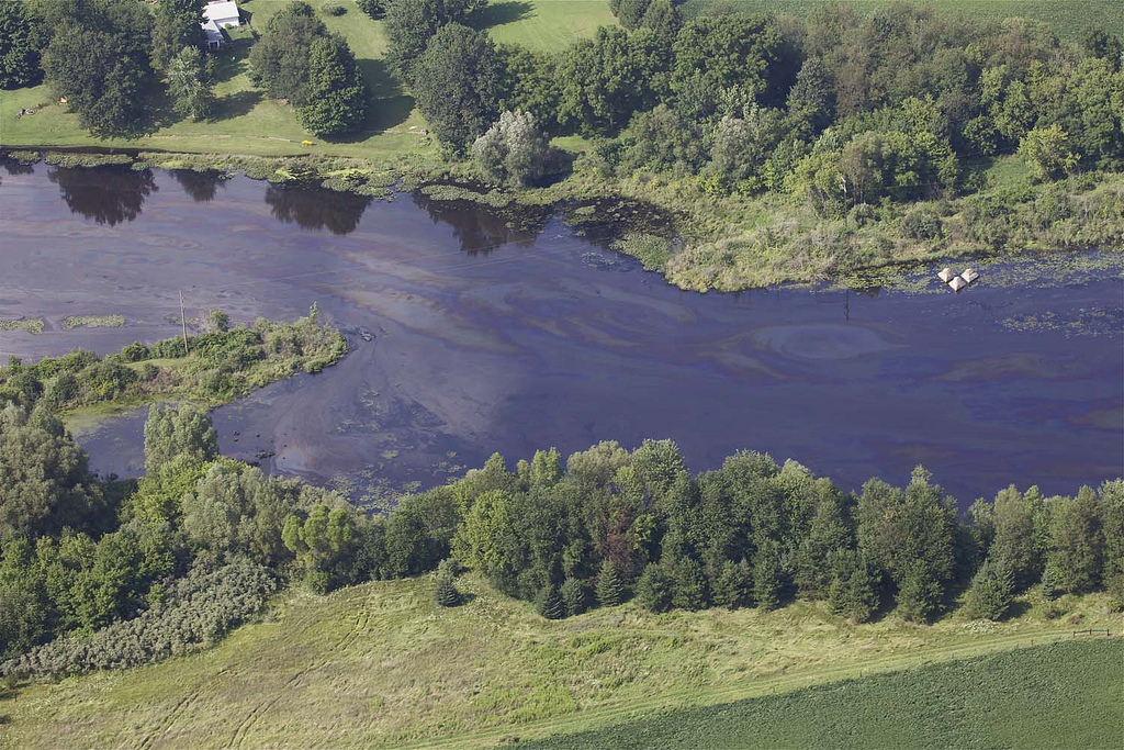 Oil in the Kalamazoo River on July 28, 2010, three days after an Enbridge pipeline burst, causing the worst inland oil spill in U.S. history. The spill was particularly difficult to clean up because some of the oil sank.