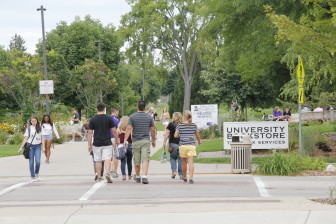 Students walk through the University of Wisconsin-Whitewater campus during the first week of classes in early September. UW-Whitewater is one of three UW-System four-year campus that acknowledge using students to buy drugs from others in controlled drug buys. Photo shot Sept. 5, 2014.