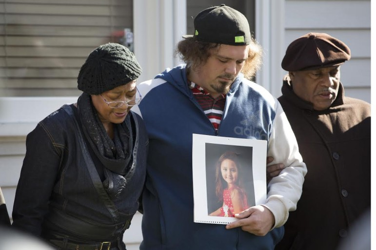 Robert Petersen holds a photo of his 5-year-old daughter, Laylah, who was killed Nov. 6 in Milwaukee while sitting indoors on her grandfather's lap.