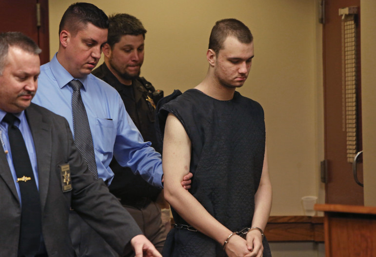 Dean Sutcliffe, 17, of Mazomanie, right, who was charged with the shooting deaths of Ariyl Brady, 16, and Chris Schwichtenberg, 39, is led into his initial appearance at the Dane County Public Safety Building in Madison on Feb. 12. He is scheduled to go to trial in July.