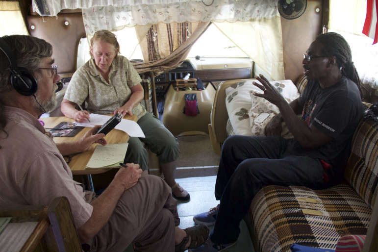 Gil Halsted of Wisconsin Public Radio and WCIJ Managing Editor Dee Hall interview Talib Akbar about his years in solitary confinement in Wisconsin prisons. Photographed June 30, 2015, in Akbar's camper.