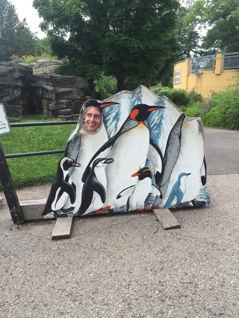 Sean Kirkby helps fellow Center reporter intern Tara Golshan collect audio at the Madison zoo.
