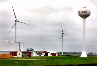 These wind turbines, a joint venture between Organic Valley and Gundersen Lutheran Health System, loom over Organic Valley's distribution center in Cashton, Wis.