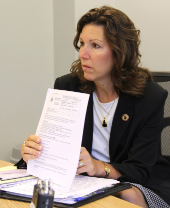 Cathy Jess, administrator of the Wisconsin Department of Corrections' Division of Adult Institutions, holds a copy of the agency's new policy that calls for less time in isolation for inmates who break prison rules. The Wisconsin Center for Investigative Journalism filed a lawsuit earlier this year to gain access to records about the new policy.