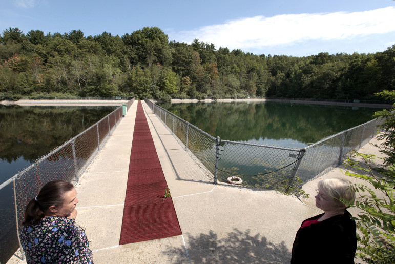A pair of reservoirs on the northern end of the Badger Army Ammunition Plant once provided water for the 7,000-plus acre weapons manufacturing facility. Although the pumping system has been disabled, the pools still hold water. Pictured near the facility during a tour of the grounds in 2012 are Sauk County Supervisor Donna Stehling, left, and Joan Kenney, former Badger Army Ammunition Plant commander's representative.