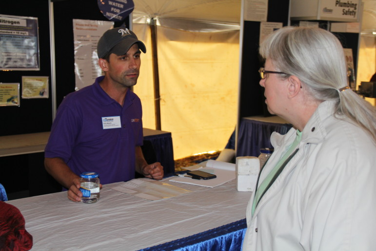 "Kevin Masarik, a groundwater education specialist at the University of Wisconsin-Stevens Point's Center for Watershed Science and Education, is seen here at Wisconsin Farm Technology Days near Sun Prairie in August. ""I don't think we have fully realized what the extent of nitrate (in groundwater) is throughout Wisconsin yet,"" he said."