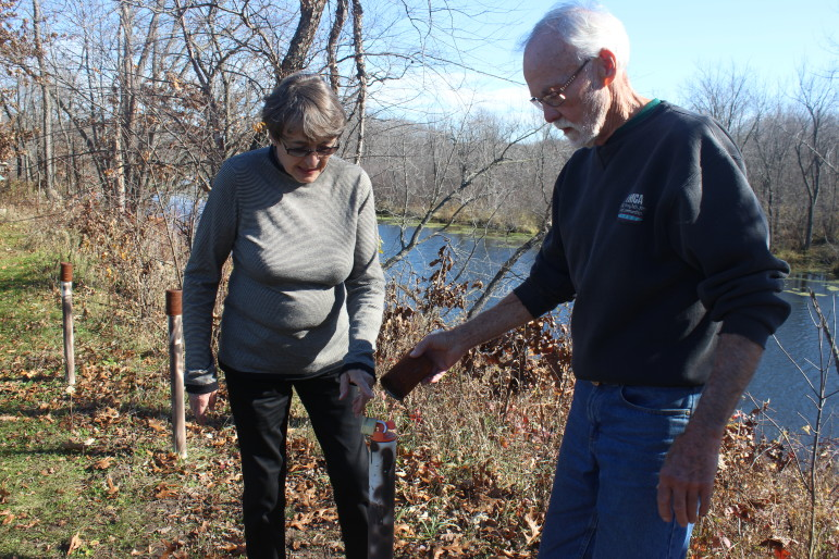 Doug and Sherryl Jones show a monitoring well on their property in rural Spring Green. The couple's drinking water was found in 2007 to contain twice the health limit for nitrate. They initially switched to bottled water but now have a reverse osmosis system to remove nitrate. The Joneses are among 16 petitioners seeking to force the state Department of Natural Resources to better enforce part of the Clean Water Act.