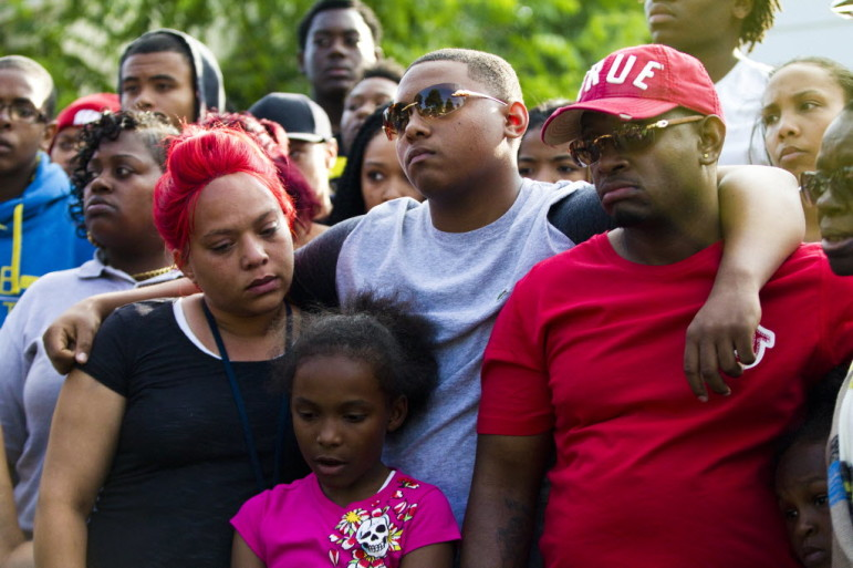 (From left) Arifah Akbar, Nazir Akbar and Katraile Scott stand together during a vigil for Tariq Akbar, on July 7. Tariq was shot to death July 3 in Milwaukee after watching a fireworks display with his friends. This year, Milwaukee has seen a sharp increase in shootings, which can cost taxpayers and victims tens if not hundreds of thousands of dollars each in medical bills, incarceration costs and other expenses.
