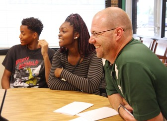 Madison Memorial High School Principal Jay Affeldt, right, says stereotyping can hurt student performance. Affeldt graduated from Memorial in 1991, returned as a teacher in 1999 and is now in his second year as principal. Affeldt joined students Robert Bennett and Geresa Homesly in a roundtable discussion on race-based achievement gaps.