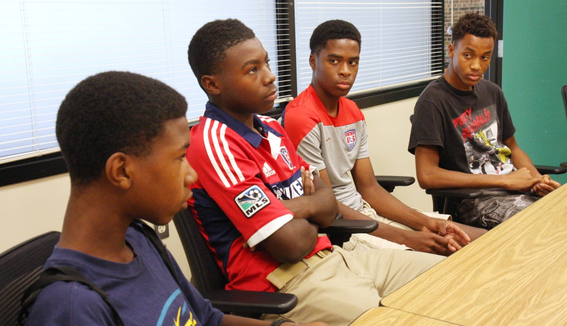 From left, Memorial High School students William Lemkuil, Demitrius Kigeya, Odoi Lassey and Robert Bennett say they face racial stereotypes at school.