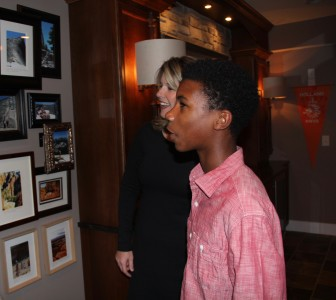 Madison Memorial High School sophomore William Lemkuil looks at a wall of family photos with his mother, Amy, in the basement of their home in Verona. Amy says she worries about the negative stereotypes that William faces as a black student in Wisconsin.