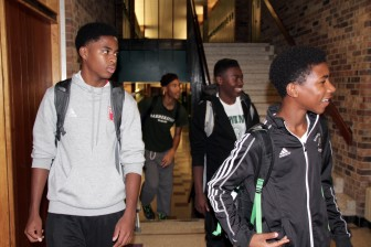 From left to right and back to front, Robert Bennett, Demitrius Kigeya, Odoi Lassey and William Lemkuil walk down the halls of Madison Memorial High School. Even though these four students are high-achieving, participate in sports and are active members of the school's Black Student Union, they still face negative stereotypes as black students in Madison.