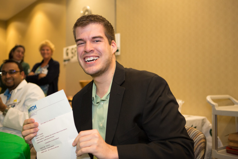 Michigan State University student Bradley Burmeister reacts to receiving word in 2014 that he will serve his medical residency at the Medical College of Wisconsin in Milwaukee. Burmeister was motivated to study science and go to medical school after participating in a project at Seymour High School to test local drinking water. It showed many residents in and around the Outagamie County community, including his family, had dangerously high levels of arsenic in their water.