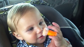 Casheous, then 9 months old, examines his finger after a test that showed the level of lead in his blood was more than three times the federal threshold for poisoning. His mother, Crystal, has become an advocate for blood testing children for lead, which can cause lower IQ and behavior changes.
