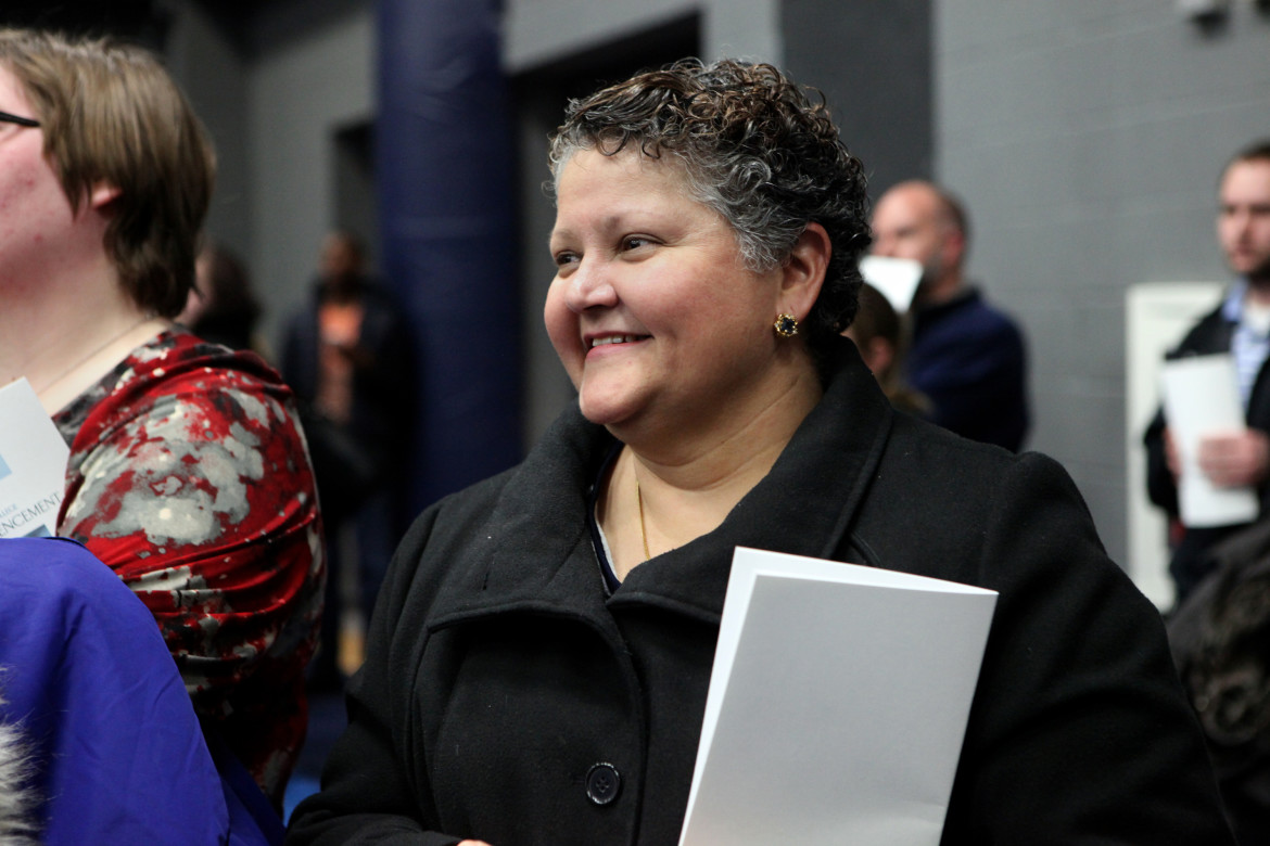 "Eileen Guzman watches her son, Ien, graduate from Madison College in December. She raised her two children at Packer Townhouses and says she considers the community home. If the learning centers were not at the apartment complexes, she said, ""we would have lost a lot of kids."""