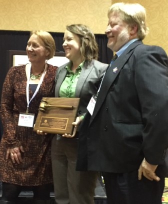 Wisconsin Center for Investigative Journalism Managing Editor Dee J. Hall, left, and former Center reporter Bill Lueders, right, receive the Golden Gavel Award from the State Bar of Wisconsin's Katie Stenz for coverage of solitary confinement in Wisconsin.