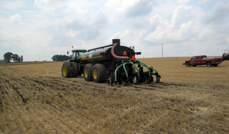 Manure is spread during a demonstration at Crave Brothers Farm in Dodge County during Farm Technology Days on July 22, 2009. Manure from large dairy operations has caused drinking water contamination in Brown and Kewaunee counties in recent years.