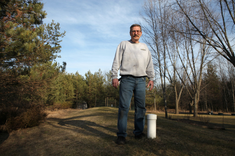 Alan Ashley stands on his mound septic system outside his house in Ephraim. In 1975, Ashley installed what he says was one of the first mound systems in Door County. The cost to replace the system for his four-bedroom house in 2007 was around $14,000.