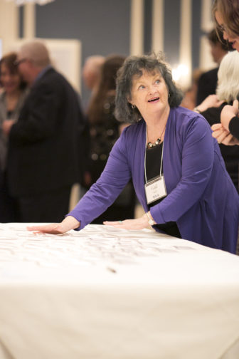 Gail Kohl hands out name tags at the 2016 Wisconsin Watchdog Awards.