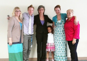 Robyn Ellis, to the right of Judge Mary Triggiano, center, is seen on the day of her graduation from Milwaukee County's Family Drug Treatment Court in 2014. Completing the program allowed Ellis to regain custody of her daughter, Gaeliona, then 5. Also celebrating were, from left, Megan Koch, Ellis' sister Joslyn Zinkowski, and her grandmother Marion Schroetter, far right.