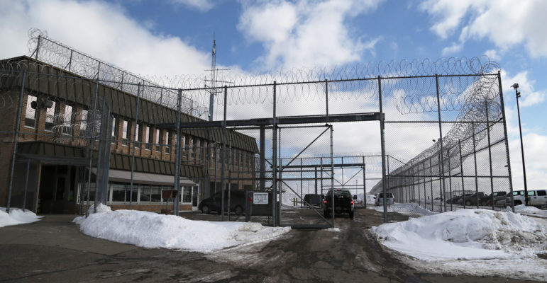 A security fence surrounds the entrance to the Lincoln Hills School for Boys and Copper Lake School for girls complex in rural Irma, Wis., seen in this file photo. The two schools are under federal investigation for alleged abuse and violations of the civil rights of juvenile inmates housed there.
