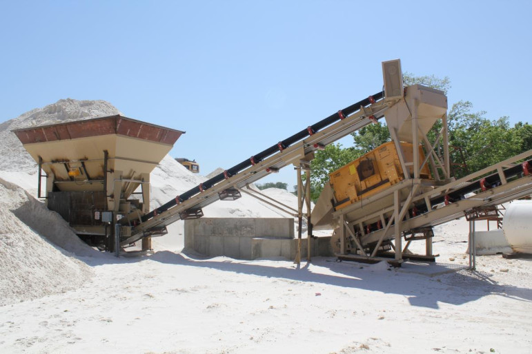 At Pattison Sand Co., seen here in 2011, fine-grained silica sand is funneled onto conveyor belts that move it through a giant, hissing rotary dryer, which uses heat to dry any wetness the sand retains after being washed. Some residents living around Pattison Sand's proposed expansion at its site in Clayton County, Iowa, are concerned about being exposed to silica dust, which can cause lung damage if inhaled.