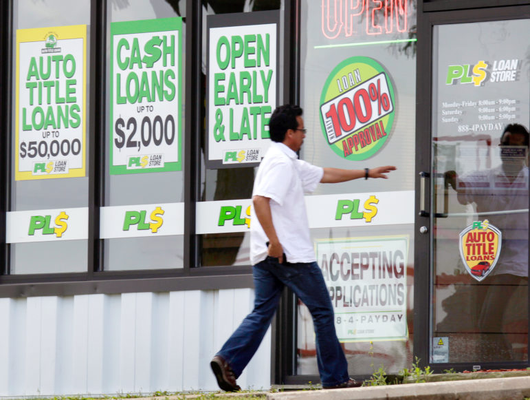 A customer enters the PL$ Payday Loan Store on Red Arrow Trail in Madison. In 2015, the average annual interest rate on payday loans in Wisconsin was 565 percent.