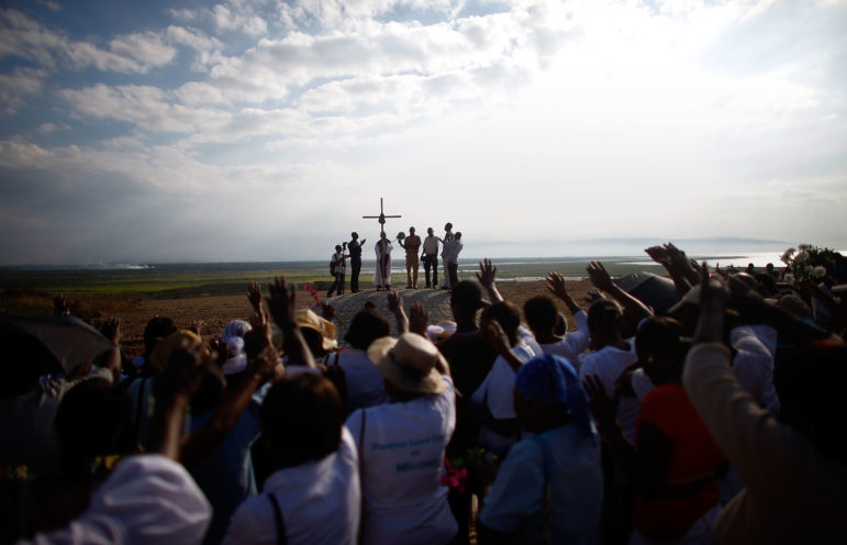 PParishioners from the Saint Louis King of France Catholic church in Port-au-Prince sing and cry as they dedicate a monument they built on the site of the mass graves from the earthquake in Titanyen, Haiti.