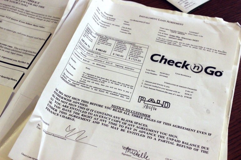 """The truth-in-lending box on Michelle Warne's loan explains how much she owes. With principal, interest and fees, the $740 loan will cost her $1,723. """"I wish I would have read the fine print,"""" she said."""