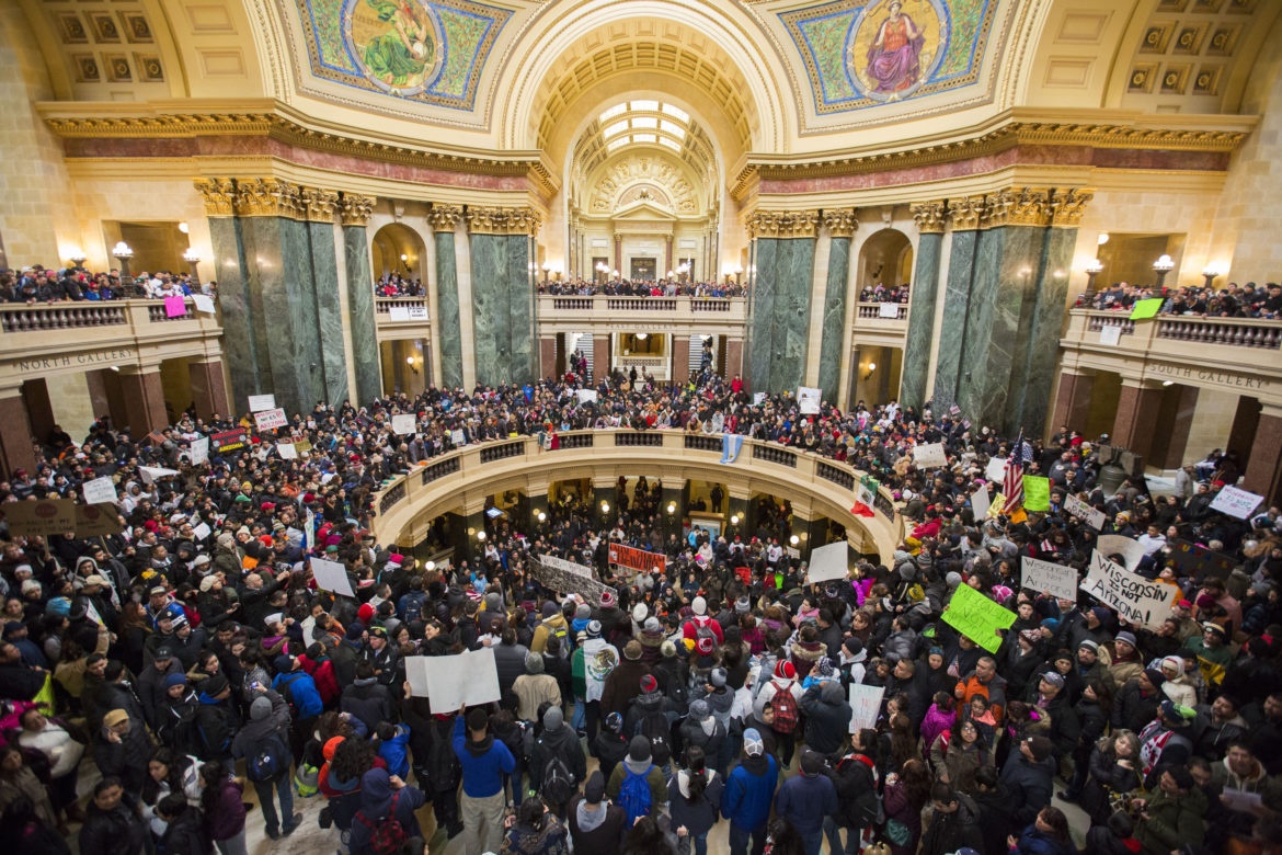Latino protesters and supporters participate in the 'Dia Sin Latinos,' or Day Without Latinos, event inside the Capitol building to protest immigration bills on Feb. 18, 2016, Madison, Wis. The protest also was designed to highlight Hispanic's contribution to Wisconsin's economy.