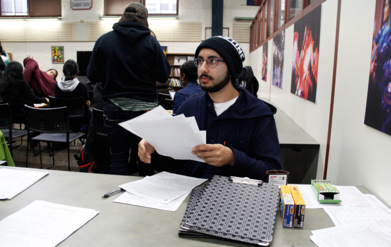 Ali Khan, 19, became more politically active in the past year in response to divisive rhetoric about Muslim Americans. Here he registers students at the Oct. 12, Black and Brown Vote event at the Multicultural Student Center at the University of Wisconsin-Madison.
