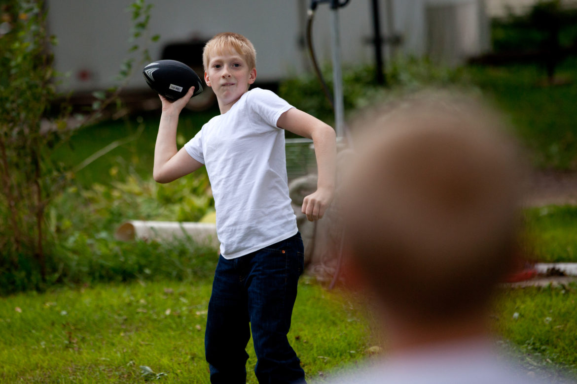 Jacob Reeves plays with his younger brother, Billy, foreground, at their home in rural Stoughton. In 2014, Jacob was diagnosed with juvenile dermatomyositis — a rare disease that his mother Dawn attributes to the high level of atrazine found in their well water.