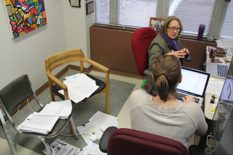 Managing Editor Dee J. Hall and reporting intern Abigail Becker work on fact-checking an upcoming investigation. Bridgit Bowden/Wisconsin Public Radio