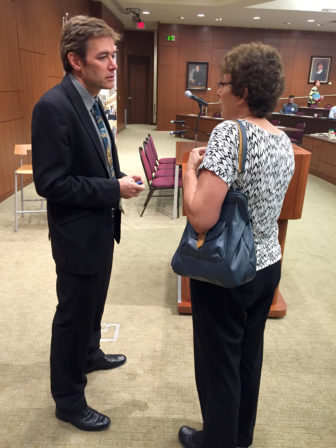 Virginia Tech University professor Marc Edwards talks with Milwaukee Water Works Superintendent Carrie Lewis before a symposium on drinking water Sept. 7, at Marquette University Law School in Milwaukee. Edwards said Wisconsin's failure to notify local water managers of new lead testing protocols in the wake of the Flint, Michigan, lead crisis could pose a danger to the public.