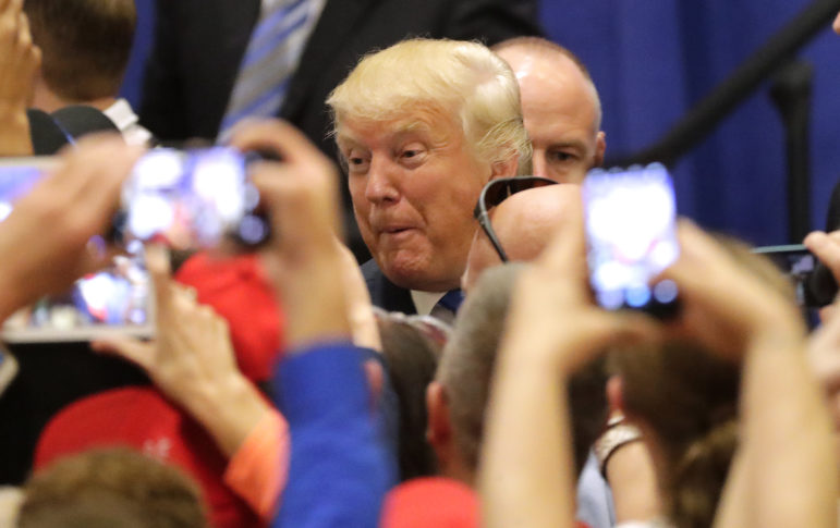 Presidential candidate Donald Trump greets fans after his campaign rally at the KI Convention Center in Green Bay, Wis. on Oct. 17, 2016. Trump is among the candidates whose campaigns owe communities in Wisconsin thousands of dollars for police protection in 2016, according to an investigation by the Center for Public Integrity.