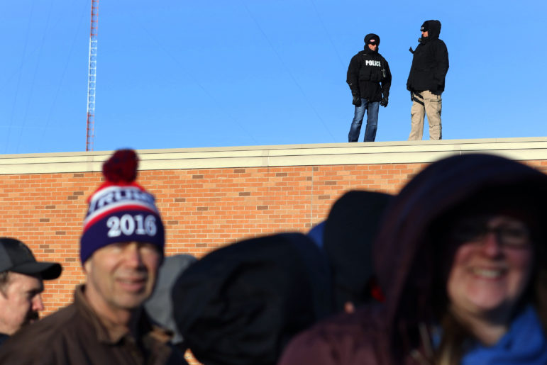 Law enforcement monitors the crowd outside of Memorial High School as they wait to see Donald Trump speak April 2, 2016 in Eau Claire, Wis. Trump is among the candidates whose campaigns owe communities in Wisconsin thousands of dollars for police protection in 2016, according to an investigation by the Center for Public Integrity.