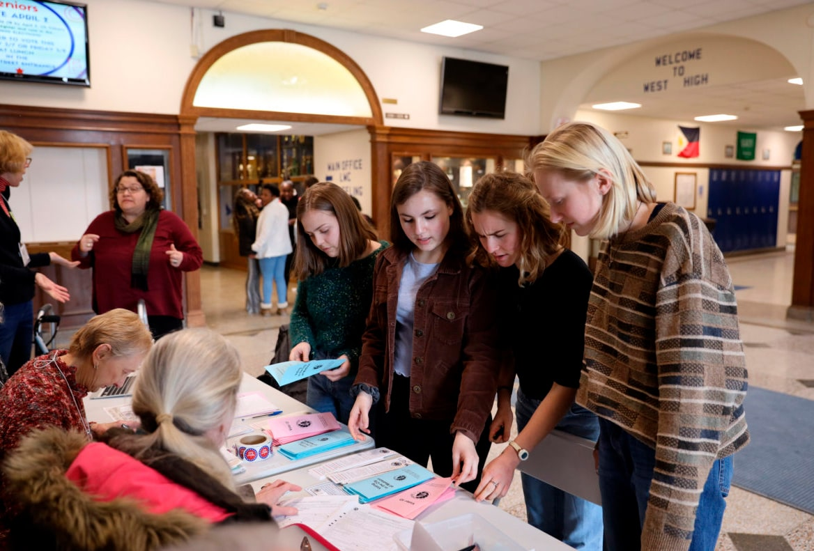 Photo of young people registering to vote