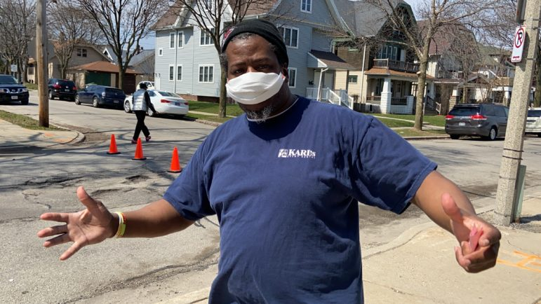 Hamid Abd-Al-Jabbar, a violence interrupter and outreach worker for 414 Life, a violence-prevention program based in Milwaukee neighborhoods and hospitals, helped distribute 1,500 masks on April 7, 2020, when Wisconsin held in-person voting despite the coronavirus.